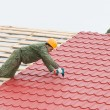 Roofing work with metal tile — Stock fotografie #5419371