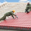 Roofing work with metal tile — Stockfoto