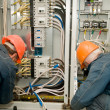 Stock Photo: Electricians at work
