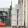 Warehouse forklift loader at work — Stock fotografie
