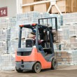 Warehouse forklift loader at work — Stockfoto