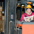 Warehouse worker in stacker — Stock Photo #5419423