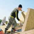 Roofing works with insulation material - Stock Photo