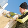 Stock Photo: Roofer with measure tape