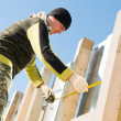 Roofer with measure tape — Stock Photo #5419662