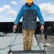 Flat roof covering works with roofing felt - Stock Photo