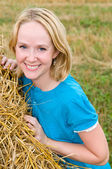 Young woman in a field — Stock Photo
