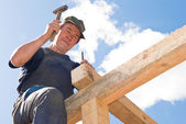 Roofing works with hammer — Stock Photo