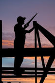 Builder at roofing works — Stock Photo