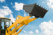Risen loader shovel — Stock Photo