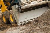 Skid steer loader works — Stock Photo