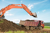 Excavator loader and dumper truck — Stock Photo