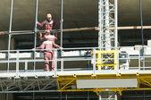 Restoration work of buildings at climbing platform — Stock Photo