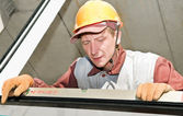 Builder laborer using level tool — Foto Stock