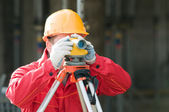 Surveor at work with level — Stock Photo