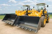 Two wheel loaders excavators — Stock Photo