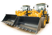 Wheel loaders excavators isolated — Stock Photo