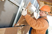 Worker builder at facade tile installation — Stock Photo