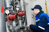 Heating engineer in boiler room — Foto Stock