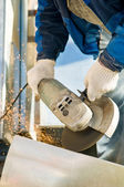 Catting metal with angle grinder saw — Stock Photo