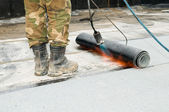 Roofing with tar felt and blowpipe flame — Stock Photo