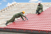 Roofing work with metal tile — Stock Photo