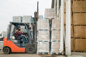 Warehouse forklift loader at work — Stock Photo