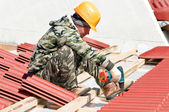 Builder working with screwdriver and nail — Stock Photo