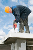Builder roofer with drill — Stock Photo
