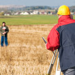 Surveyot theodolite works — Stock Photo