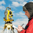 Surveyor works with theodolite — Stock Photo #5421210