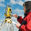 Surveyor works with theodolite — Stock Photo #5421215