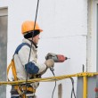 Laborer in helmet at facade works — Stock Photo #5421437