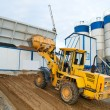 Loader works at concrete plant — Stock Photo