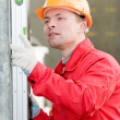 Builder with digital level — Stock Photo #5421503