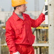 Stock Photo: Builder with digital level