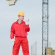Builder operating the tower crane — Stock Photo