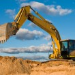 Track-type loader excavator at sand quarry — Stock Photo #5421703