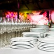 White plates and stemware glass at party — Stock Photo