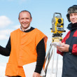 Surveyor workers with theodolite equipment — Stock Photo #5427696