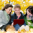 Group of smiling young students outdoors — Stock Photo