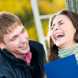 Pair of happy students outdoors — Stock Photo