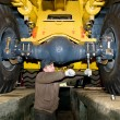 Stok fotoğraf: Maintenance work of heavy loader