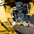 Maintenance work of heavy loader — Stockfoto