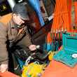Stock Photo: Checking hydraulic system of machine