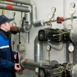 Heating engineer in boiler room — Stock Photo #5427854