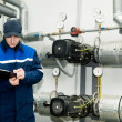 Heating engineer in boiler room — Stock Photo #5427857