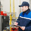 Heating engineer in boiler room — Stock Photo #5427879