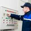 Electrician at voltage adjusting work — Stock Photo #5427890