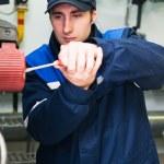 Heating engineer in boiler room — Stock Photo #5427908